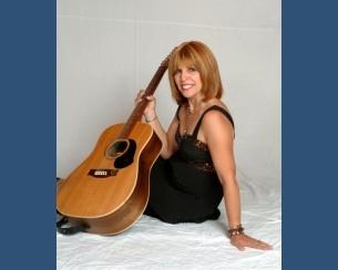 305x244_305x244_roseanne__guitar